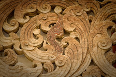 Naga wood carving  in Wat Ton Kwain, Chiangmai Royalty Free Stock Image