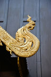 Naga wood craving decoration on gable of Thai temple Stock Photos