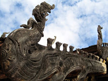 """Naga's roof terrace in """"Wat Phra That Lampang Luang"""" and clouds filled the sky. Stock Photo"""