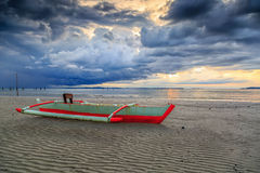 Nagalang beach 01. Boat and cloud with beautiful sunrise Stock Image