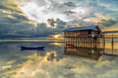 Nagalang beach 03. House, Boat and cloud with beautiful sunrise Royalty Free Stock Photo