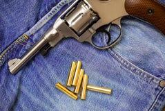 Nagan revolver with ammunition Royalty Free Stock Photos