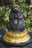 Nagano - Japan, June 3, 2017: Statue of Mujina, a devoted raccoon dog, at the Buddhist Kenzoji temple stock image
