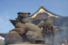 Japanese lion sculpture on the incense burner of Zenko-ji temple royalty free stock photos