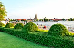Nagaraphirom Park - Wat Arun. The temple is probably best known for its Khmer-style prang ('pagoda'), which is decorated with shells and pieces of porcelain Stock Photography