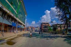 NAGARKOT, NEPAL OCTOBER 11, 2017: Beautiful view of dowtown with unidentified people riding their motorbikes around the Royalty Free Stock Image