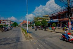 NAGARKOT, NEPAL OCTOBER 11, 2017: Beautiful view of dowtown with unidentified people walking and riding their motorbikes Stock Photo