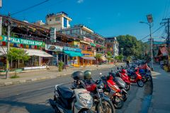 NAGARKOT, NEPAL OCTOBER 11, 2017: Beautiful view of dowtown with unidentified people walking, with some motorcycles Royalty Free Stock Photography