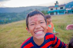 NAGARKOT, NEPAL OCTOBER 11, 2017: Close up of unidentified group of playful little children playing and enjoying time royalty free stock photo