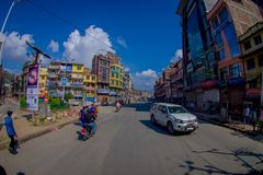 NAGARKOT, NEPAL OCTOBER 11, 2017: View of dowtown with unidentified people riding their motorbikes around the city in Stock Image