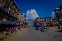 NAGARKOT, NEPAL OCTOBER 11, 2017: View of dowtown with unidentified people riding their motorbikes around the city in Royalty Free Stock Photo