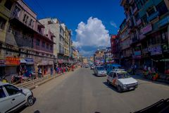 NAGARKOT, NEPAL OCTOBER 11, 2017: View of dowtown with unidentified people riding their motorbikes around the city in Royalty Free Stock Photos