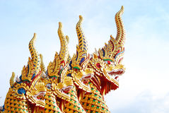 Nagas head. Four heads of yellow Nagas in Thai temple Royalty Free Stock Photos