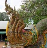 Nagas i början till en trappa till en tempel Royaltyfria Foton