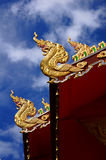 Nagas Roof. In Thai Temple.It is a stucco-coated with gold. It is located in the north of Thailand stock photography