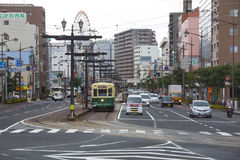 NAGASAKI, JAPAN - August 19, 2015 cars and vintage tram on the r Royalty Free Stock Image