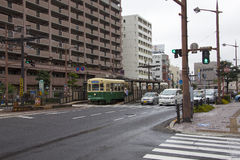 NAGASAKI, JAPAN - August 19, 2015 cars and vintage tram on the r Royalty Free Stock Images