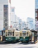Nagasaki, Japan - 23. Februar 2012: Nagasaki-Stadt mit Tram-Eisenbahn Lizenzfreies Stockfoto
