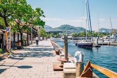 Dejima Wharf shopping and restaurant street with sea in Nagasaki, Japan. Nagasaki, Japan - May 25, 2015 : Dejima Wharf shopping and restaurant street with sea stock photo
