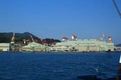 NAGASAKI JAPAN - 2016: Sikt från Nagasaki port på staden och de omgeende bergen Royaltyfria Bilder