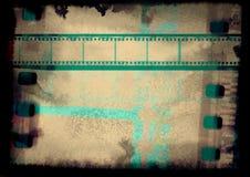 Negative grunge 35mm vintage film negative on grunge old background. Negative grunge 35m film strip Monochrome metallic 35 m film strip on background, Vintage Royalty Free Stock Photos