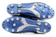 Nagelneue glänzende blaue Fußballmatten/-schuhe Stockfotos