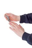 Nagelscherer in der Verbundhebelart in den männlichen Händen Stockfotos
