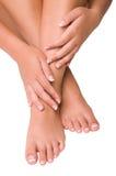 Nagelsorgfalt für die Hände und die Füße der Frauen Stockbilder