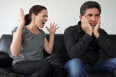 Nagging wife complains to her husband Stock Images