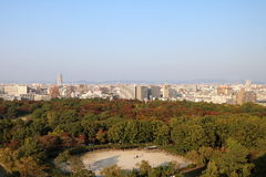 Nagoya Aerial View 1. Aerial view of Nagoya City in Aichi Prefecture in Japan at dusk during the golden hour with Autumn foliage visible in the foreground Stock Photography