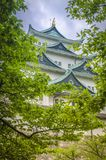 Nagoya Castle throught the trees in Japan. Imagawa Ujichika built the original castle around the year 1525. Oda Nobuhide took it from Imagawa Ujitoyo in 1532 and royalty free stock photos