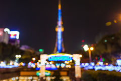 Nagoya city night time with lights blur bokeh. Royalty Free Stock Images