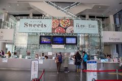 Entrance of Nagoya city Science Museum. Nagoya, Japan - December 2018 : Ticket Office Sell with tourists of Nagoya city Science Museum, the world`s largest dome royalty free stock photo