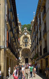 Nagusia street and The Basilica of Saint Mary of Coro. Donostia. Stock Images