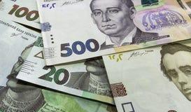 Nah konkurrieren Sie oben von ukrainischem Geld 100, grivnia 500 um Entwurf und kreative Projekte lizenzfreies stockfoto