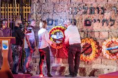 A representative from the townspeople lay a wreath at the memorial at a commemorative ceremony in the Memorial Site To the Fallen. Nahariyya, Israel, April 17 royalty free stock photo