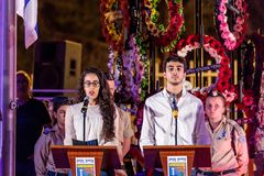 Representatives of the city`s youth organization deliver a speech in honor of those who died at the ceremony in the Memorial Site. Nahariyya, Israel, April 17 royalty free stock photos