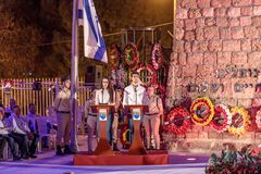 Representatives of the city`s youth organization deliver a speech in honor of those who died at the ceremony in the Memorial Site. Nahariyya, Israel, April 17 royalty free stock images