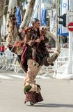 Jumpers on the springs, dressed in fairy costumes participate in the carnival of Adloyada in Nahariyya, Israel. Nahariyya, Israel, March 02, 2018 : Jumpers on Stock Image
