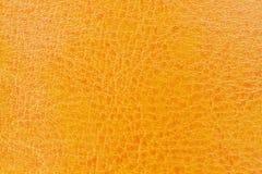 Nahaufnahme auf orange ledernem Hintergrund Lizenzfreies Stockfoto