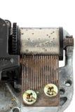 Nahaufnahme der alter Spieluhrbewegungstrommel und -zinken Stockfotos