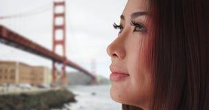 Nahaufnahme der Asiatin schauend weg von Kamera lizenzfreie stockfotos