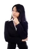 Nahaufnahme der attraktiven Geschäftsfrau denkend und betrachtend Stockbild