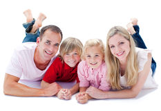 Nahaufnahme der Familie liegend auf dem Fußboden Lizenzfreies Stockbild