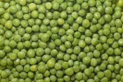 Nahaufnahme der grünen Erbsen Stockbilder