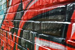 Nahaufnahme der Graffitibacksteinmauer Stockbilder