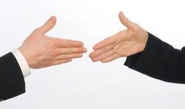 Nahaufnahme der männlichen und weiblichen Leitprogramme ungefähr, zum der Hände zu rütteln stockfotos