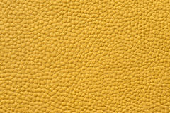 Nahaufnahme der nahtlosen gelben ledernen Beschaffenheit Lizenzfreies Stockbild