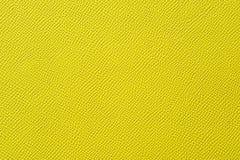 Nahaufnahme der nahtlosen gelben ledernen Beschaffenheit Stockbild