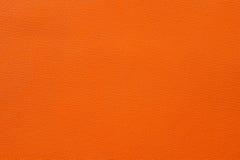 Nahaufnahme der nahtlosen orange ledernen Beschaffenheit Lizenzfreie Stockfotografie